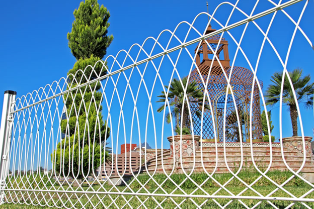 Image 6. Ornamental metal fence with curved and angular design (Internet - Aug2019). PROJECTS RF USA